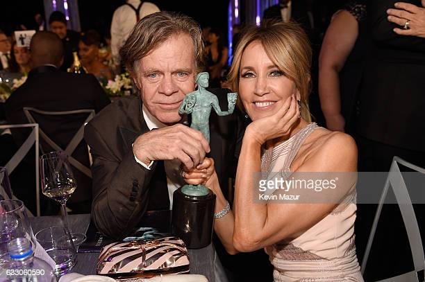 Actor William H Macy poses with the Outstanding Performance by an Actor in a Comedy Series award for 'Shameless' and Felicity Huffman during The 23rd...