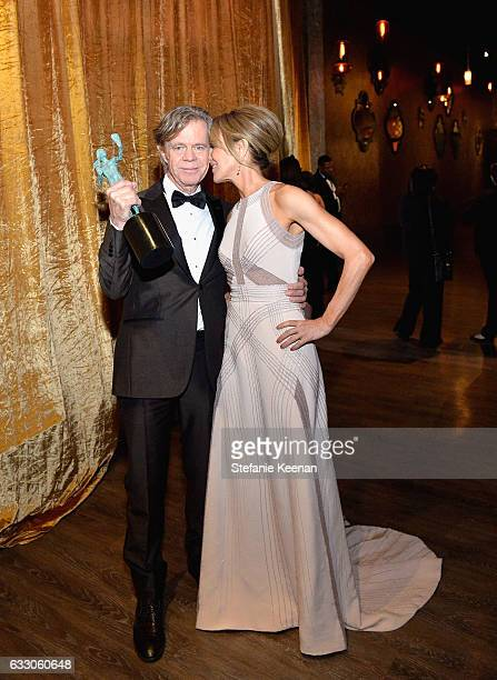 Actor William H Macy winner of the award for Outstanding Performance by a Male Actor in a Comedy Series for 'Shameless' poses backstage with wife...