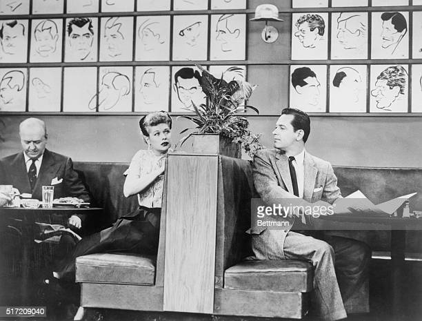 Actor William Holden is shown in a guest appearance on I Love Lucy with Lucille Ball and William Frawley in view The scene takes place in the Brown...