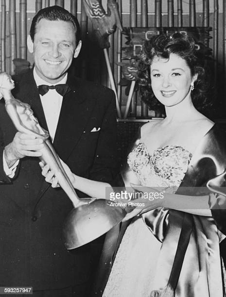 Actor William Holden presenting a gold 'Henrietta' award to Susan Hayward from the Foreign Press Associated at the Golden Globe Awards February 17th...