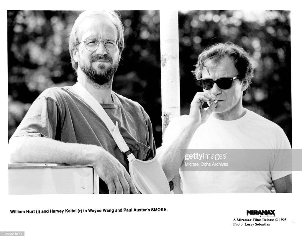 Actor William Hurt and Harvey Keitel on set of the movie ' Smoke' , circa 1995.