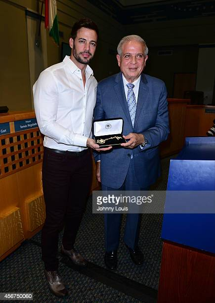 Actor William Levy receives a key to the city of Miami from Mayor Tomas Regaladoas at Miami City Hall on October 6 2014 in Miami Florida