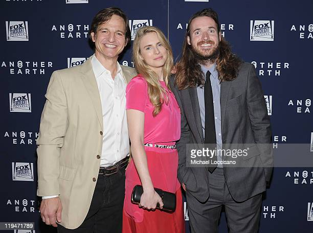 Actor William Mapother actress Brit Marling and director Mike Cahill attend the Another Earth premiere at Landmark's Sunshine Cinema on July 20 2011...