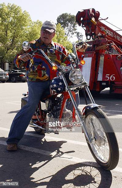 Actor William Shatner poses on a motorcycle at the 14th Annual Hollywood Charity Horse Show on May 1 2004 at the Los Angeles Equestrian Center in...