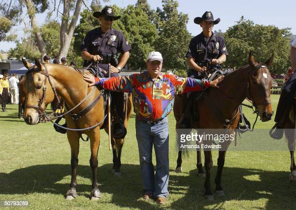 Actor William Shatner poses with policemen at the 14th Annual Hollywood Charity Horse Show on May 1 2004 at the Los Angeles Equestrian Center in...