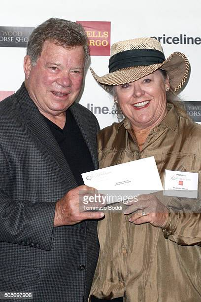 Actor William Shatner poses with the honoree during the Gifting Ceremony For Pricelinecom Hollywood Charity Horse Show at The Six Restaurant on...