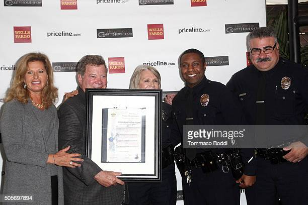 Actor William Shatner poses with the honorees during the Gifting Ceremony For Pricelinecom Hollywood Charity Horse Show at The Six Restaurant on...