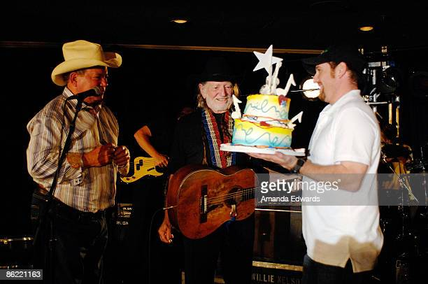 Actor William Shatner presents musician Willie Nelson with a birthday cake at the 19th Annual 'Hollywood Charity Horse Show' at the Los Angeles...