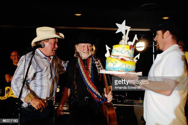 """Actor William Shatner presents musician Willie Nelson with a birthday cake at the 19th Annual """"Hollywood Charity Horse Show"""" at the Los Angeles..."""