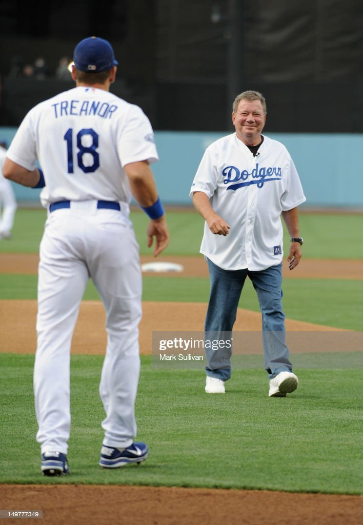 Actor William Shatner (R) with Los Angeles Dodger catcher Matt Treanor after throwing out the ceremonial first pitch during Star Trek Night at Dodger Stadium on August 3, 2012 in Los Angeles, California.