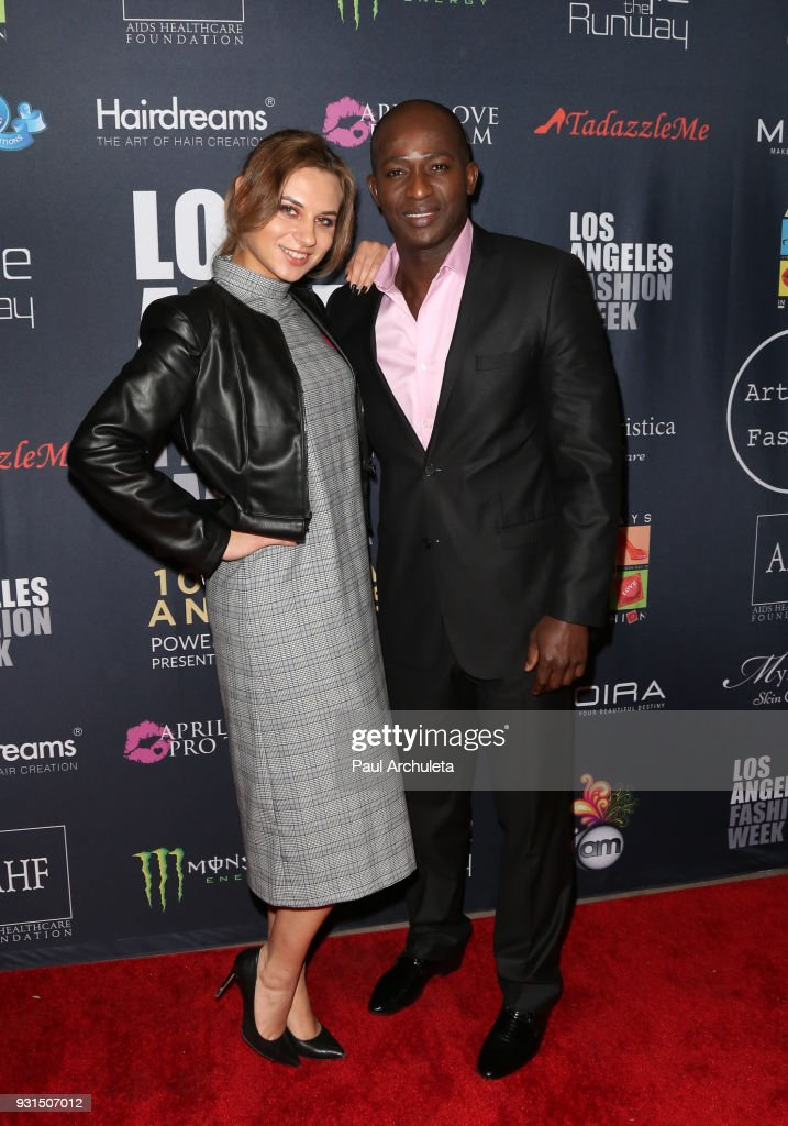 Actor Wills Canga (R) and Ekaterina Yakovleva (L) attend the Domingo Zapata Fashion Show at the Los Angeles Fashion Week 10th season anniversary at The MacArthur on March 12, 2018 in Los Angeles, California.