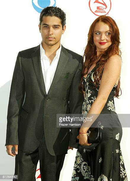 Actor Wilmer Valderrama and actress Lindsay Lohan attends the '5th Annual Latin Grammy Awards' held at the Shrine Auditorium on September 1 2004 in...