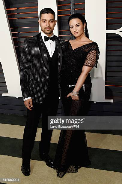Actor Wilmer Valderrama and recording artist Demi Lovato attend the 2016 Vanity Fair Oscar Party Hosted By Graydon Carter at the Wallis Annenberg...