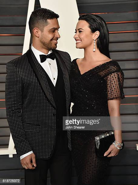 Actor Wilmer Valderrama and singer Demi Lovato arrives at the 2016 Vanity Fair Oscar Party Hosted By Graydon Carter at Wallis Annenberg Center for...