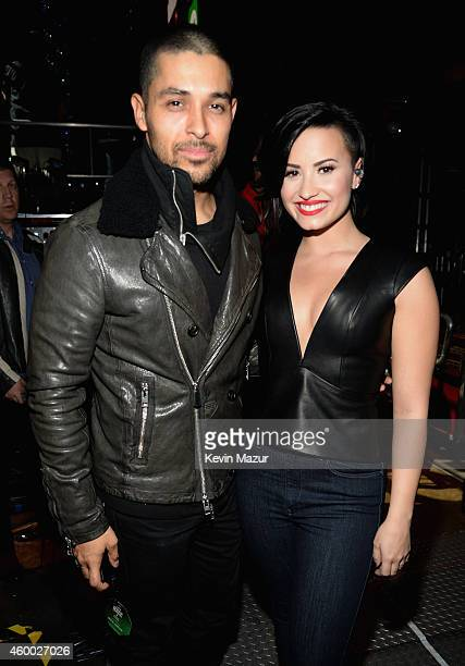 Actor Wilmer Valderrama and singer Demi Lovato attend KIIS FM's Jingle Ball 2014 powered by LINE at Staples Center on December 5 2014 in Los Angeles...
