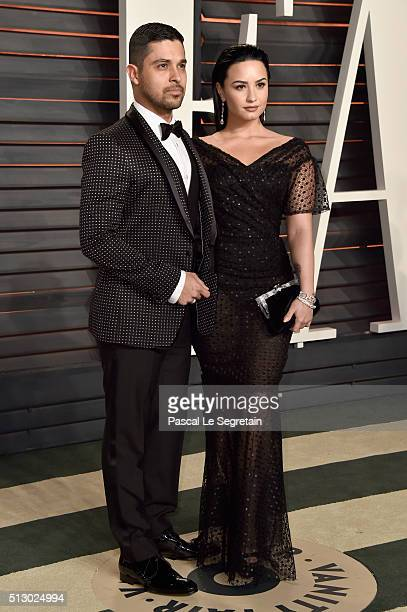 Actor Wilmer Valderrama and singer Demi Lovato attend the 2016 Vanity Fair Oscar Party Hosted By Graydon Carter at the Wallis Annenberg Center for...