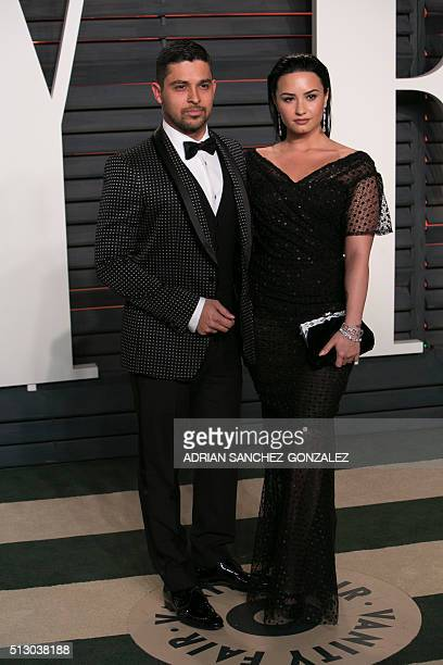 US actor Wilmer Valderrama and US singer Demi Lovato pose as they arrive to the 2016 Vanity Fair Oscar Party in Beverly Hills California on February...