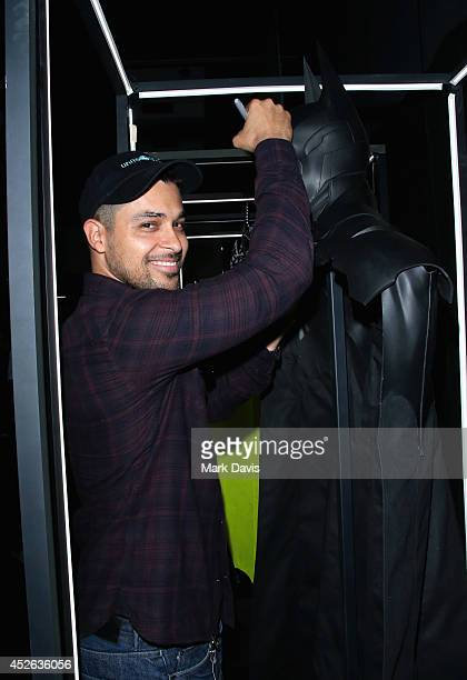 Actor Wilmer Valderrama autographs Batman's cape and cowl during Warner Bros Interactive Entertainment's 'Cape/Cowl/Create' unveiling event during...