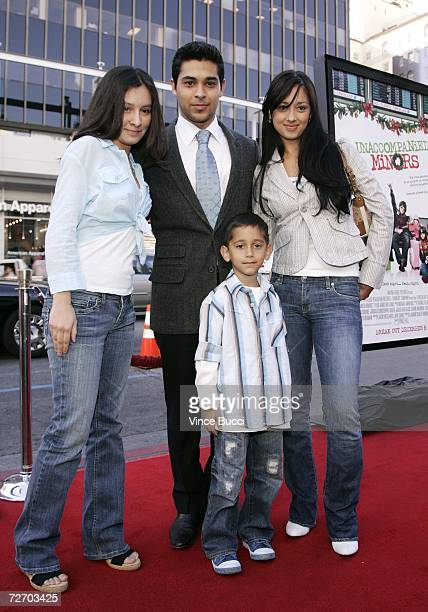 Actor Wilmer Valderrama poses with his siblings Stephanie Valderrama Christian Valderrama and Marilyn Valderrama at the premiere of the Warner Bros...