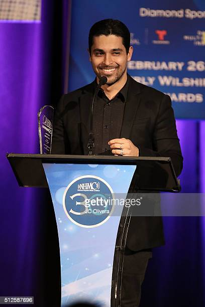 Actor Wilmer Valderrama presents 'The Outstanding Performance in Film and Television Award' to Luis Guzman during the 19th Annual National Hispanic...