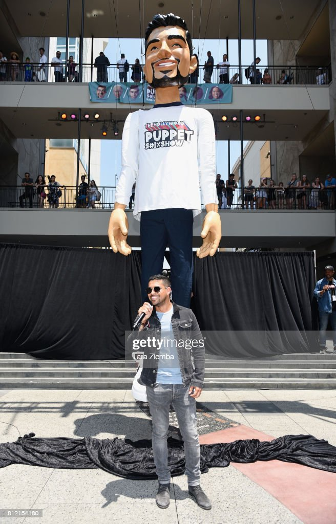 Actor Wilmer Valderrama reveals a 25ft 'Wilmer Puppet' to celebrate Fuse's 'The Hollywood Puppet Sh!tshow' at Hollywood & Highland Courtyard on July 10, 2017 in Hollywood, California.
