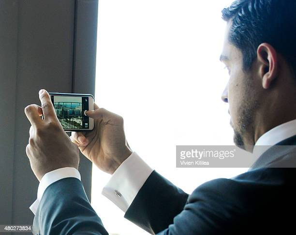 Actor Wilmer Valderrama takes a photo of the view of the Minority Report billboard at SiriusXM's Entertainment Weekly Radio Channel Broadcasts From...