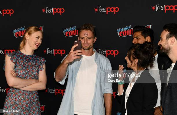 Actor Wilson Bethel takes a selfie as Deborah Ann Woll, Joanne Whalley, Jay Ali and Charlie Cox watch at Marvel's DAREDEVIL panel during New York...