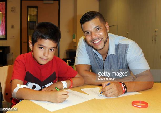 Actor Wilson Cruz from the cast of FOX's New Show 'Red Band Society' Bands For Good Marching Band Stunt at Children's Hospital Los Angeles on...