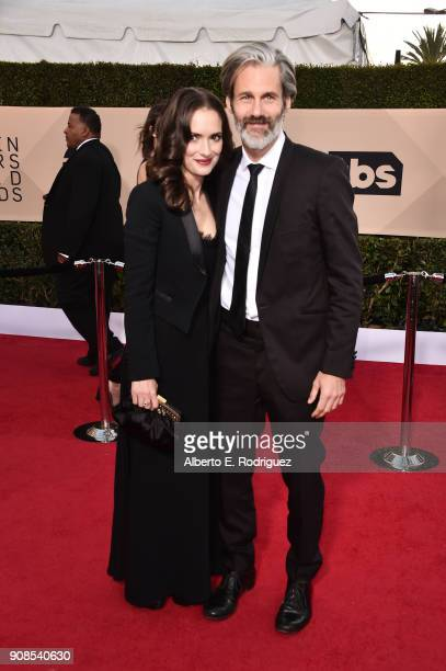 Actor Winona Ryder and Scott Mackinlay Hahn attend the 24th Annual Screen Actors Guild Awards at The Shrine Auditorium on January 21 2018 in Los...