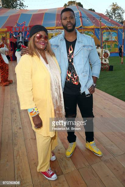 Actor Winston Duke and his mother attend Moschino Spring/Summer 19 Menswear and Women's Resort Collection at the Los Angeles Equestrian Center on...