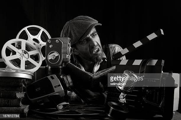 Actor with hat scowling and practicing screenplay