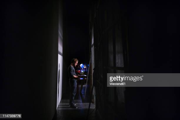 actor with script rehearsing on stage of theatre - rehearsal stock pictures, royalty-free photos & images