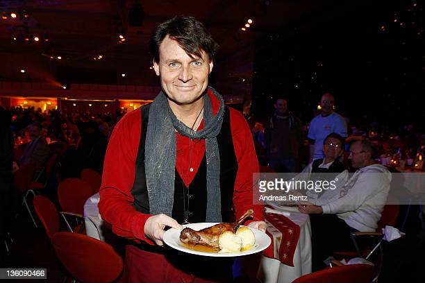 Actor Wolfgang Bahro serves Christmas goose dinner to homeless and poor people at the 17th annual Christmas Celebration for the Homeless at Estrel...