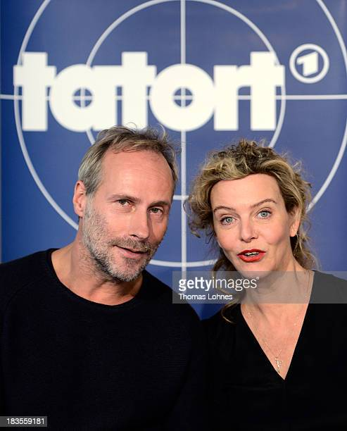 Actor Wolfram Koch and actress Margarita Broich react during a press conference on October 7 2013 in Frankfurt am Main Germany The television station...