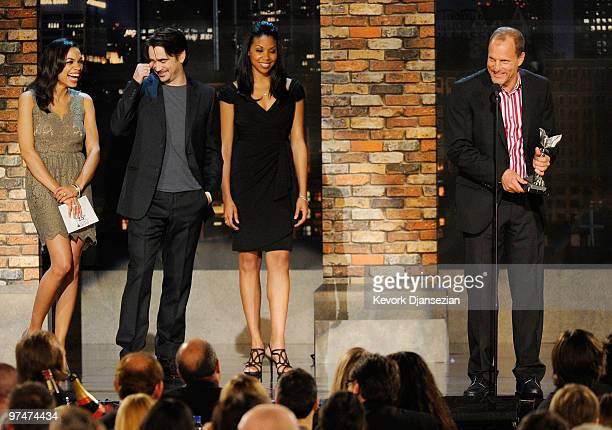 Actor Woody Harrelson accepts Best Supporting Male award for The Messenger with presenters Rosario Dawson and Colin Farrell onstage during the 25th...