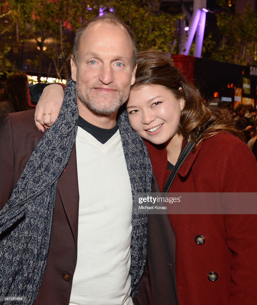 Actor Woody Harrelson (L) and daughter Zoe Harrelson attend 'Hunger Games: Mockingjay Part 2' Los Angeles Premiere Sponsored By Chrysler on November 16, 2015 in Los Angeles, California.