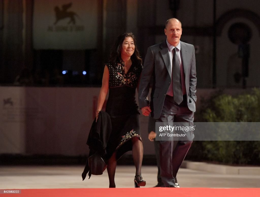 Actor Woody Harrelson and his wife Laura Louie attend the premiere of the movie 'Three Billboards Outside Ebbing, Missouri' presented in competition at the 74th Venice Film Festival on September 4, 2017 at Venice Lido. / AFP PHOTO / Tiziana FABI