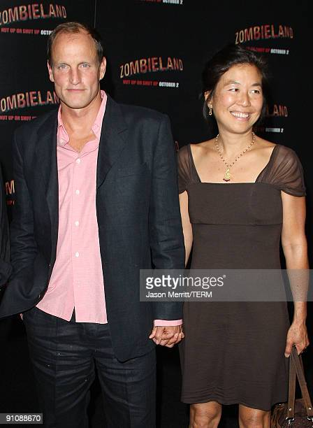 Actor Woody Harrelson and wife Laura Louie arrive at the Los Angeles premiere of Sony Pictures' 'Zombieland' on September 23 2009 in Los Angeles...