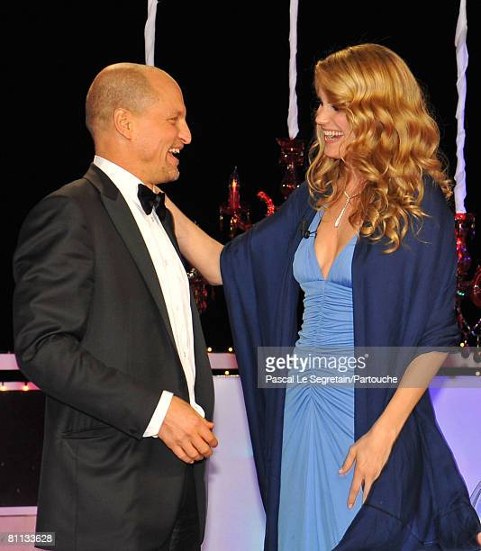 Actor Woody Harrelson embraces actress Alice Taglioni after they split the winning poker pot during the Partouche Charity Poker Festival held at Palm...