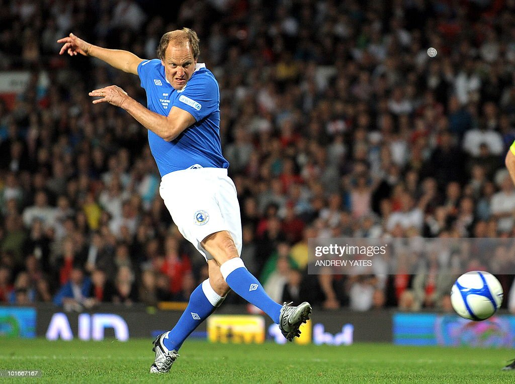 US actor Woody Harrelson scores the winning penalty for the rest of the world team during the Unicef Soccer Aid charity football match against the Rest of the world at Old Trafford in Manchester, north-west England on June 6, 2010. Soccer Aid is the brainchild of Robbie Williams and all money raised through profits from ticket sales and donations made by viewers of ITVduring the match will go to UNICEF�s invaluable work helping children around the world.