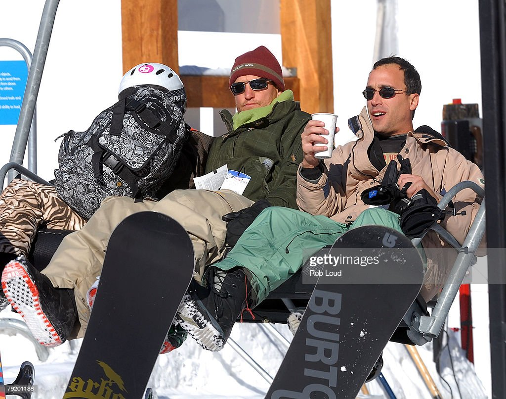 Actor Woody Harrelson (C) snowboards during the 2008 Sundance Film Festival on January 23, 2008 in Park City, Utah.