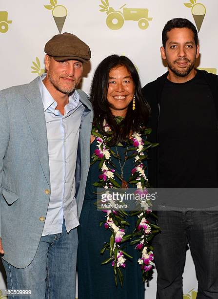 Actor Woody Harrelson wife Laura Louie and American illusionist David Blaine attend the grand opening of 'Sage Culver City' on September 13 2013 in...