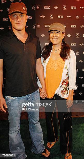 Actor Woody Harrelsonand wife Laura Louie arrive on The Green Carprt forThe Launch of the Sustainable Biodiesel Alliance at the Hard Rock Cafe in New...