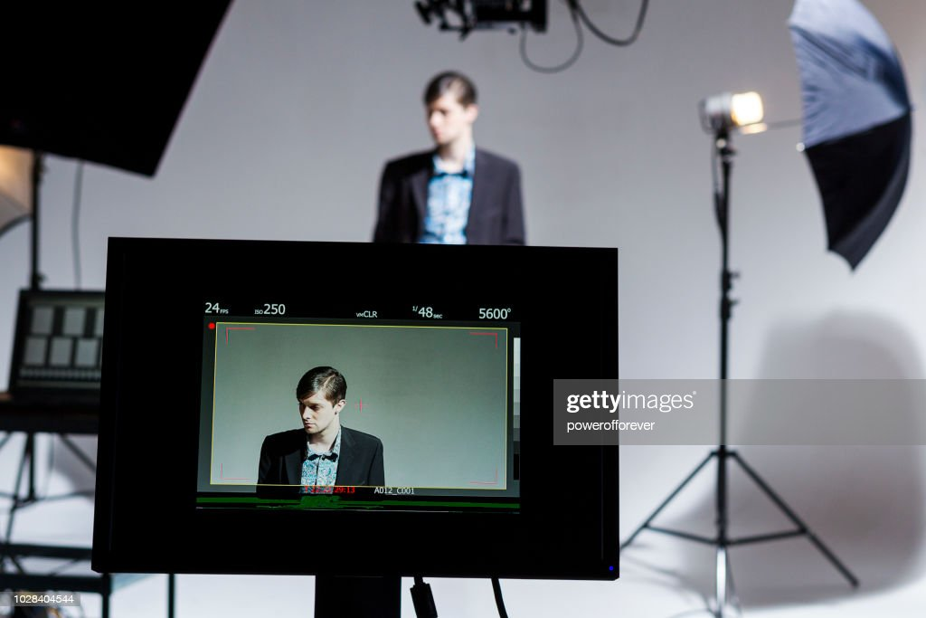 Actor working Behind the Scenes on a Film Set : Stock Photo