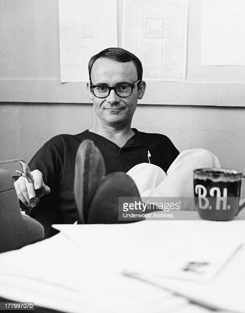 Actor writer and director Buck Henry at his desk New York New York c 1966
