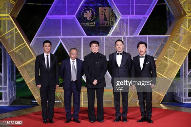 Actor Wu Jing director Yin Li actor Jackie Chan actor Chen Daoming and actor Huang Bo attend the closing ceremony of the 28th China Golden Rooster...