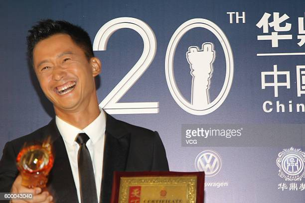 Actor Wu Jing poses during the 20th Huading Awards and China Film Satisfaction Survey Release Ceremony at Kowloon Bay International Trade Exhibition...