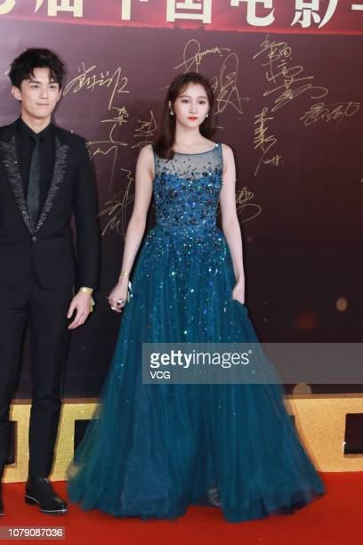 Actor Wu Lei and actress Guan Xiaotong pose on the red carpet of the 17th China Huabiao Film Awards Ceremony on December 8 2018 in Beijing China