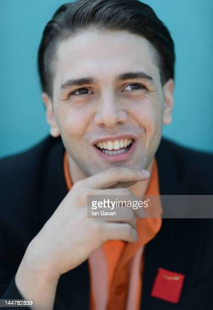 Actor Xavier Dolan poses at the 'Laurence Anyways' Portrait Session during the 65th Annual Cannes Film Festival on May 19 2012 in Cannes France