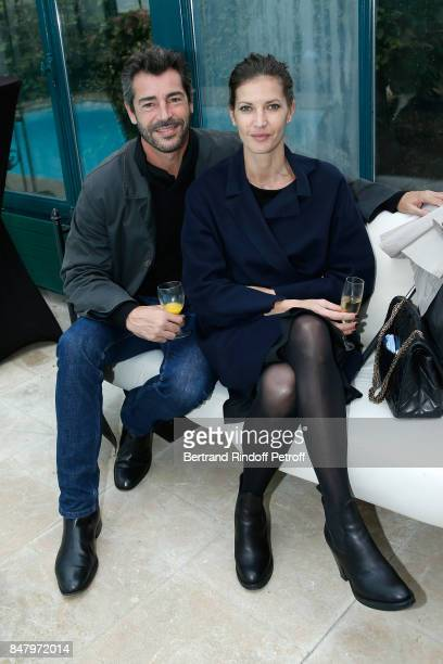 Actor Xavier Lemaitre and his companion Diana Dondoe attend the Garden Party organized by Bruno Finck companion of JeanClaude Brialy at Chateau De...